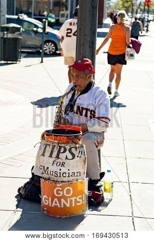 SAN FRANCISCO CALIFORNIA - SEPTEMBER 2015: An unidenfiied musician plays saxaphone outside of a Giants game on September 20 2015 in San Francisco California.