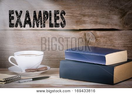 Examples. Stack of books on wooden desk.