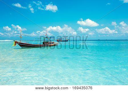 Malibu beach with boats at Koh Phangan Island, Thailand