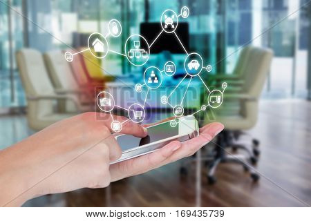 Hands showing smartphone against empty chairs in conference room 3d