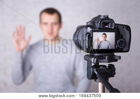 Video Blogger On Screen Of Modern Camera