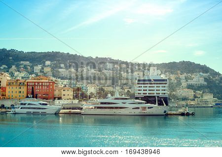 Boats and yachts moored in the port of Nice in a sunny day