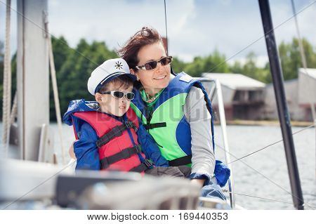 Family of two enjoying boat ride at lake, Lithuania