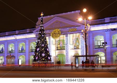 ST. PETERSBURG - January 11: Christmas tree and building of General staff on Nevsky Prospekt and Gostiny Dvor January 11 2011 in town St. Petersburg Russia.