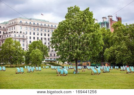 Abandoned deck chairs neatly aligned in Hyde Park, London, England