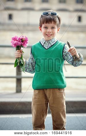 Happy little boy enjoying himself in Paris, France. Advertising, childhood, tourism, gesture and people concept