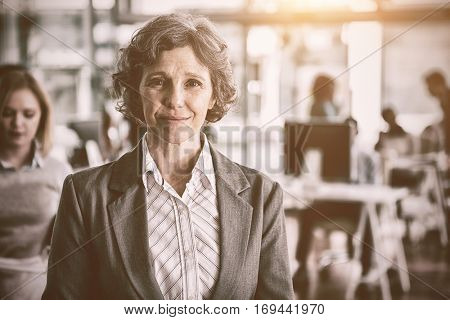 Portrait of well dressed businesswoman standing in office