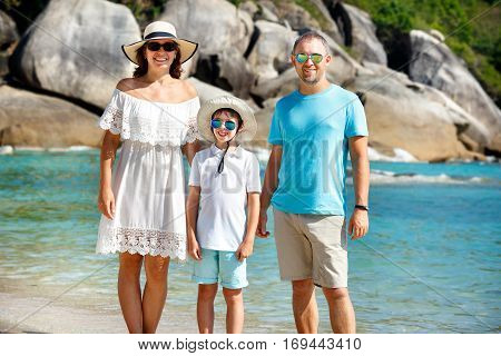 Young beautiful family along tropical beach, Koh Samui island, Thailand, Asia