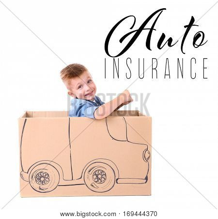 Car insurance concept. Little boy playing with cardboard box, white background
