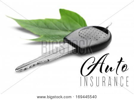 Car insurance concept. Car key with trinket on white background
