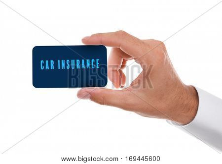 Car insurance concept. Male hand with business card on white background