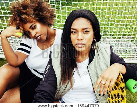 young pretty multi ethnicity afro-american girls having fun on foothball field, fan club of swag teenagers, best friends lifestyle