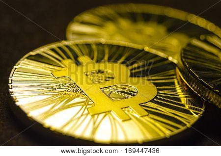 Macro View Of Shiny Coins With Bitcoin Symbol On Dark Background