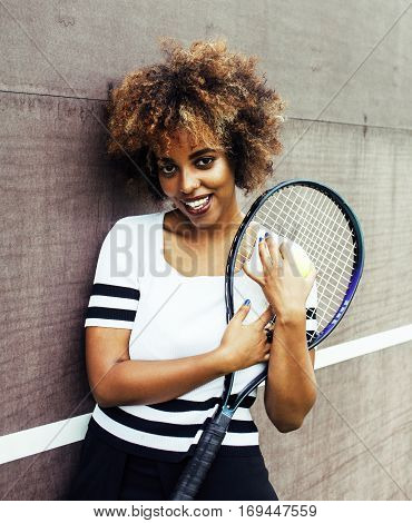 young stylish mulatto afro-american girl playing tennis, sport healthy lifestyle people concept close up
