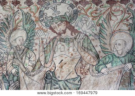 Passion scene with christ showing his bloody hands. Two angels support him. Fresco in Arhus cathedral Denmark Juni 21 2015