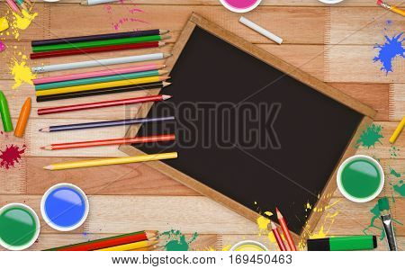 Frame of art supply against composite image of a slate with copy space