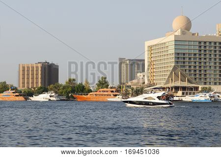 DUBAI UAE - SEPTEMBER 10: The recreation yachts are in Dubai Creek on September 10 2013 in Dubai United Arab Emirates. In the city of artificial channel length of 3 kilometers along the Persian Gulf.