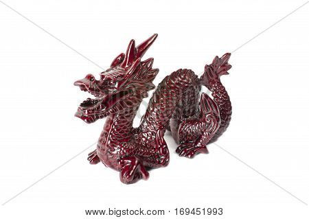 Brown traditional chinese dragon isolated on white background. Feng Shui statuette.