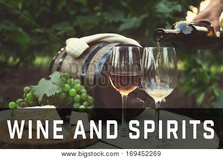 Pouring wine into glass. Text WINE AND SPIRITS on background