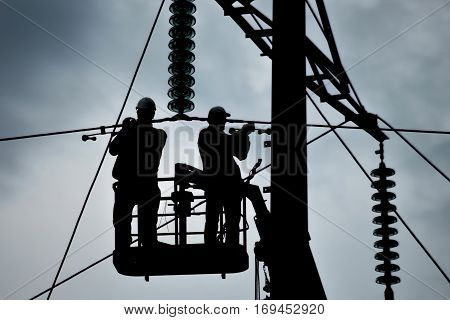 Power line support insulators and wires. Appearance of a design. Assembly and installation of new support and wires of a power line.