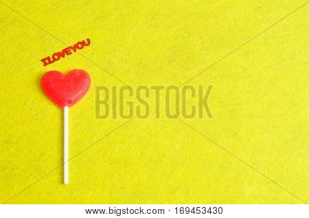 Valentines day. A heart shape lollipop with the words I love you
