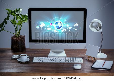 Global technology background against computer with personal organizer and belongings
