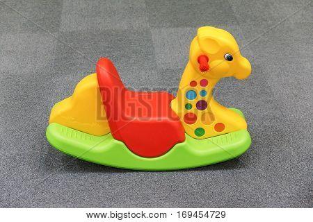 Rocking horse for kids on soft grey carpet