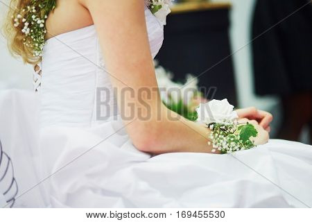 Young Bride With Flower Decorations On Her Wristle