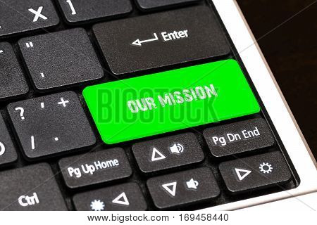 On The Laptop Keyboard The Green Button Written Our Mission