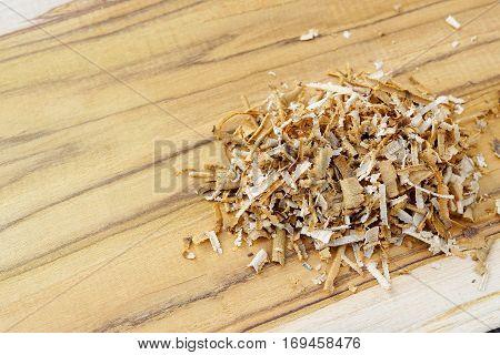 A pile of saw dust on teak wood plank