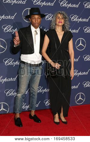 PALM SPRINGS - JAN 2:  Pharrell Williams, Mimi Valdes at the Palm Springs International FIlm Festival Gala at Palm Springs Convention Center on January 2, 2017 in Palm Springs, CA