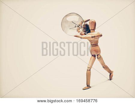 Wood Figure Mannequin carrying an incandescent light bulb