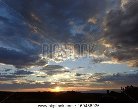 Dramatic white and gray storm clouds at sunset