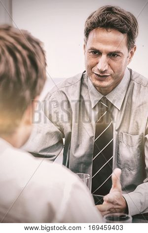 Charismatic manager during a meeting with an employee at the office