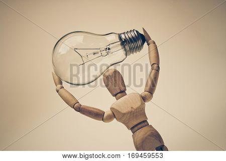 Wood Figure Mannequin carrying an incandescent light bulb / New idea concept