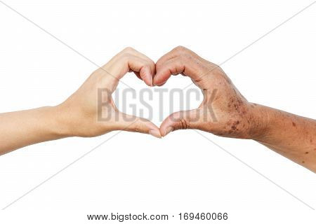 Hands of the female elderly and a young woman forming a heart shape together / Love and care elderly people concept
