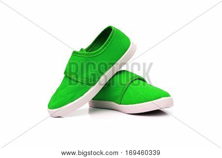 Green slip on shoes isolated on white