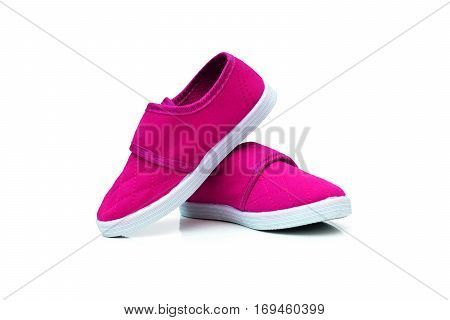 Pink slip on shoes isolated on white