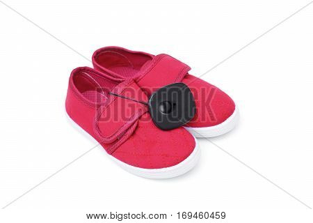 RFID hard tag attached on a red shoe isolated - Shoplifting and anti-theft system - Electronic Article Surveillance system used with high-value goods