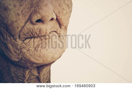 Closeup mouth of elderly woman toothless with space to add text