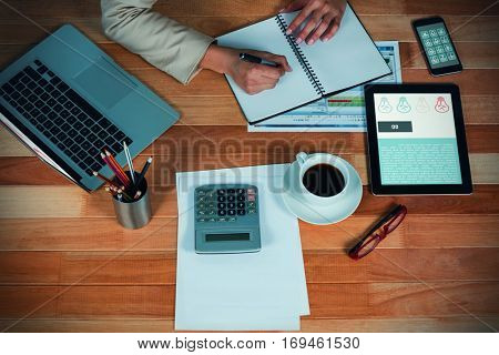 Go and lightbulbs icons against businesswoman writing on diary