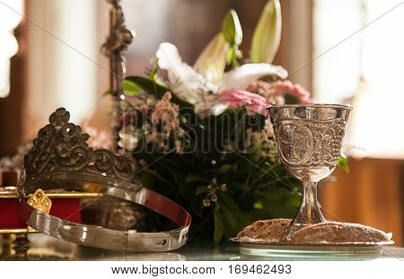 Chalice and wedding crown prepared for a weddind ceremony in a church