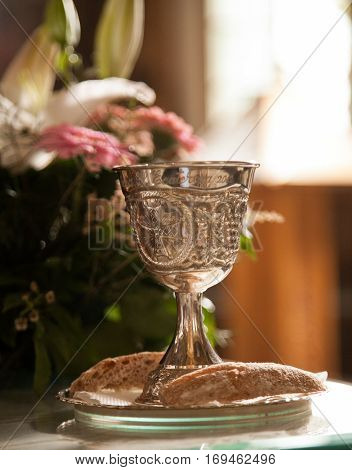 Silver chalice engraved prepared for the ritual in a church