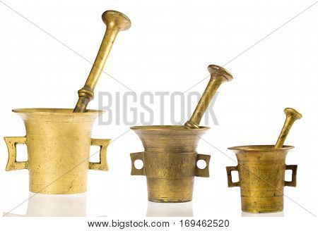 Three old bronze mortar photographed in studio on white background