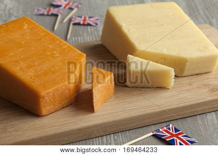 Pieces of traditional english cheese and flags