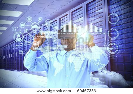 Man pointing while using virtual reality simulator against server room