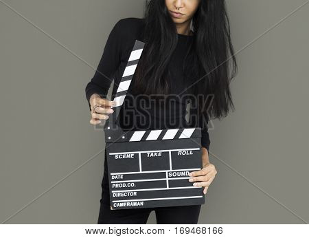 Young Women Hands Hold Clapper Board