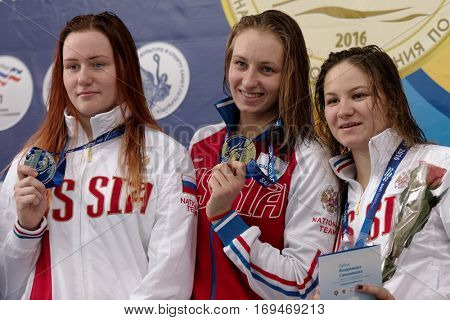 ST. PETERSBURG, RUSSIA - DECEMBER 16, 2016: Winners of X Salnikov Cup in 200 m freestyle swimming Veronika Popova (center), Irina Krivonogova (left) and Daria Mullakaeva, all from Russia