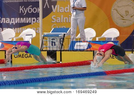 ST. PETERSBURG, RUSSIA - DECEMBER 16, 2016: Start of women backstroke swimming competition on 50 m during X Vladimir Salnikov Cup. Athletes from 6 countries participated in the competitions