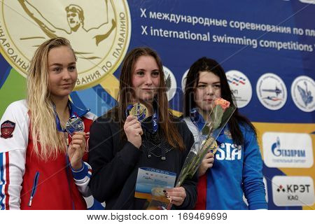 ST. PETERSBURG, RUSSIA - DECEMBER 16, 2016: Winners of X Salnikov Cup in 800 m freestyle swimming Anastasiia Kirpichnikova (center), Anna Egorova (left) and Varvara Simonova, all from Russia